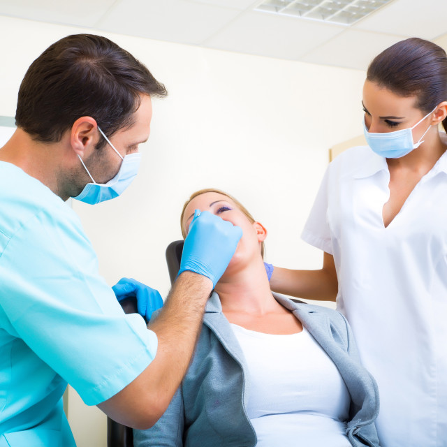 """""""Adult woman getting her checkup at the Dentist"""" stock image"""