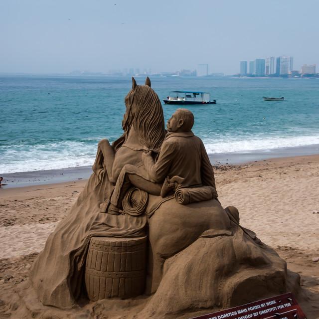"""""""Man riding horseback into the ocean"""" stock image"""