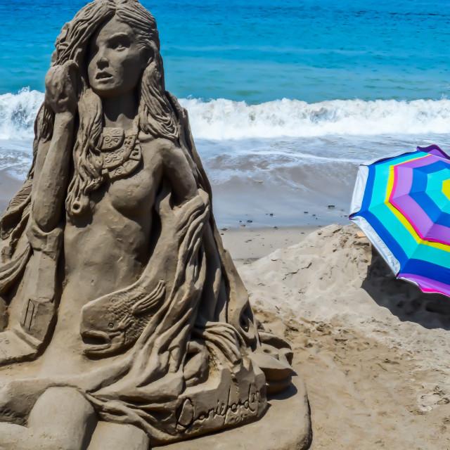 """""""Sand sculpture of girl plus umbrella"""" stock image"""