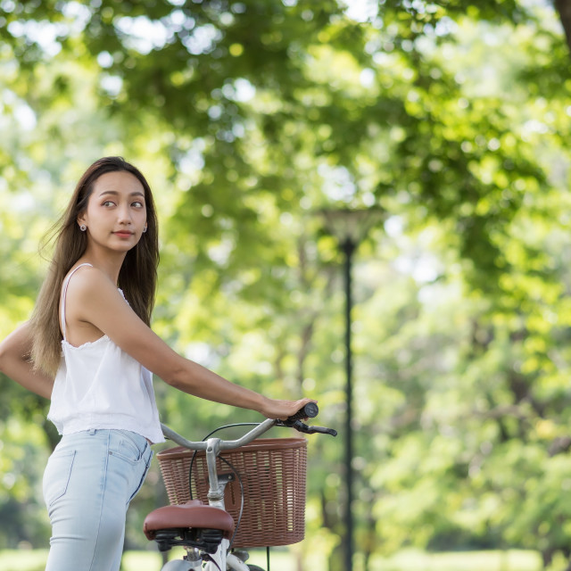 """""""Asian girl with bicycle in park"""" stock image"""