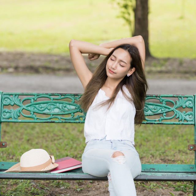 """Asian woman get fresh air in park"" stock image"
