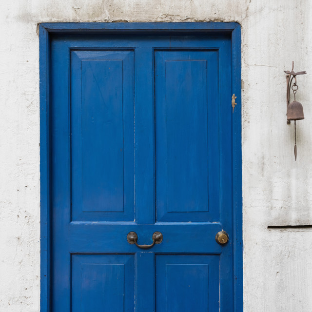 """""""Antique blue door and old bell on wall"""" stock image"""