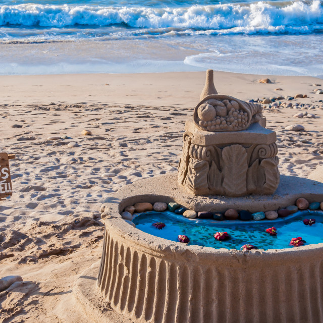 """Wishing well on the beach"" stock image"