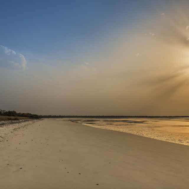 """View of a beautiful deserted beach in the island of Orango at sunset, in Guinea Bissau. Orango is part of the Bijagos Archipelago; Concept for travel in Africa and summer vacations"" stock image"