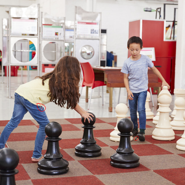 """""""Schoolchildren playing giant chess at a science centre"""" stock image"""