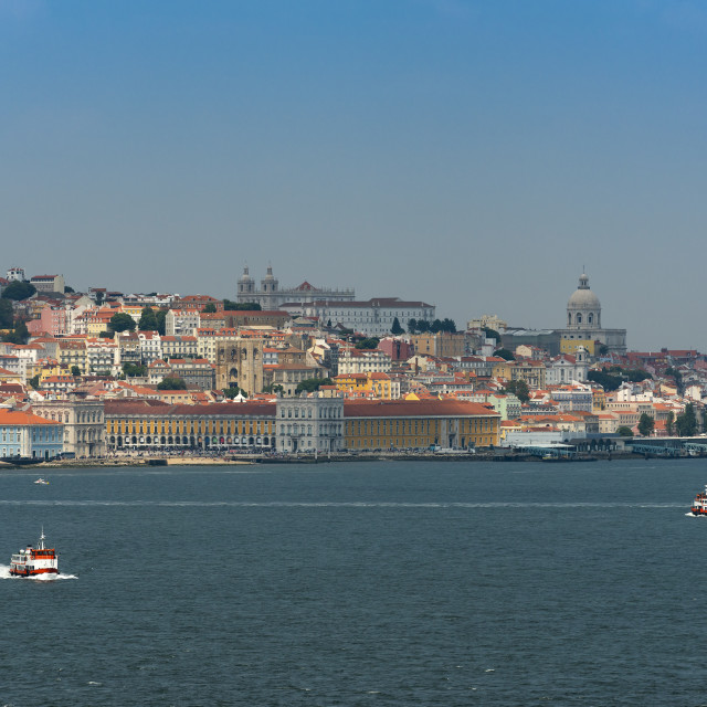 """View of the skyline of the city of Lisbon with boats (cacilheiros) on the Tagus River; Concept for travel in Portugal and visit Lisbon"" stock image"