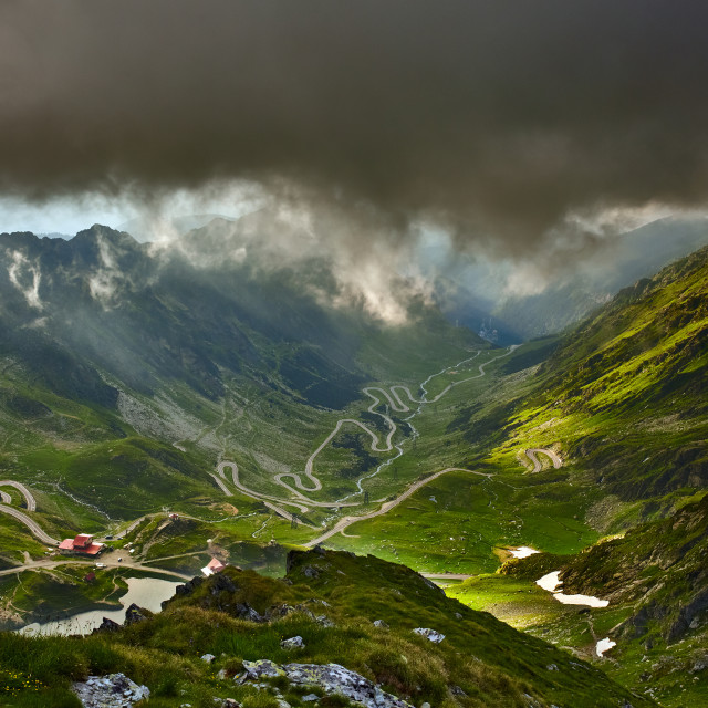 """""""Mountains and winding road before storm"""" stock image"""