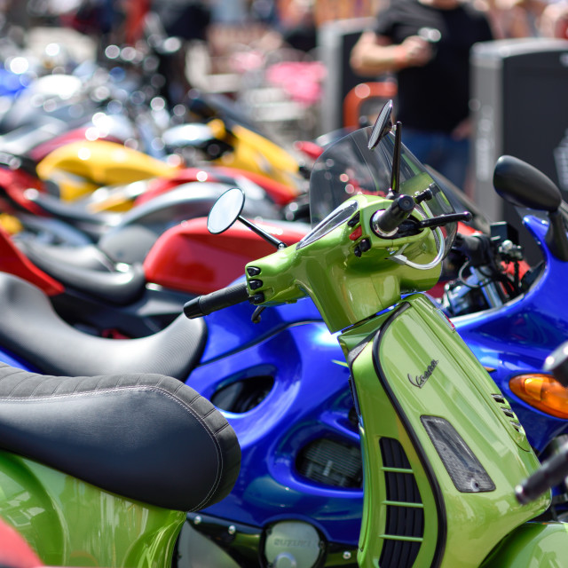 """""""Scooters and Motorcycles Parked along Matlock high street."""" stock image"""