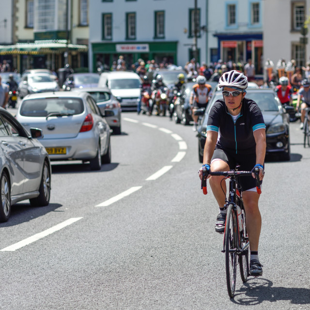 """Cyclist in Matlock Bath,Derbyshire,UK."" stock image"