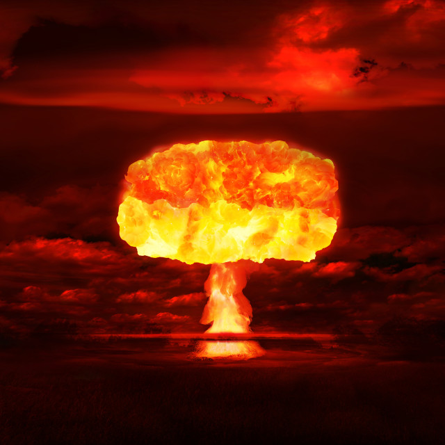 """""""Atomic bomb realistic explosion, red color with smoke on black background"""" stock image"""