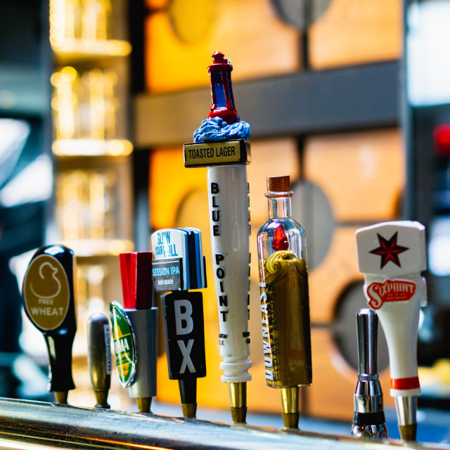 """Beer taps at a bar"" stock image"