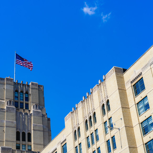 """A building with the American Flag in the background"" stock image"