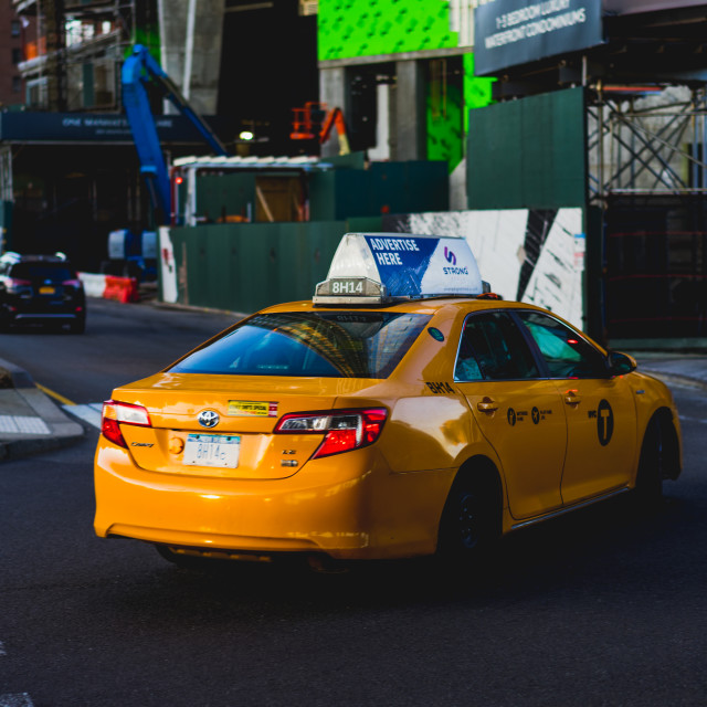 """A New York City cab under an overpass"" stock image"