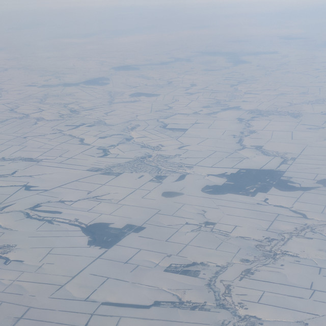 """Flying above Ukraine with lots of frozen lakes and a snow covered ground from..."" stock image"