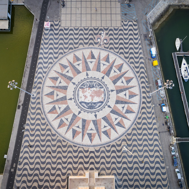 """Lisbon, Portugal - June 23, 2018: Aerial view of the marble mosaic with the compasse rose at the foot of the Monument to the Discoveries in the city of Lisbon."" stock image"