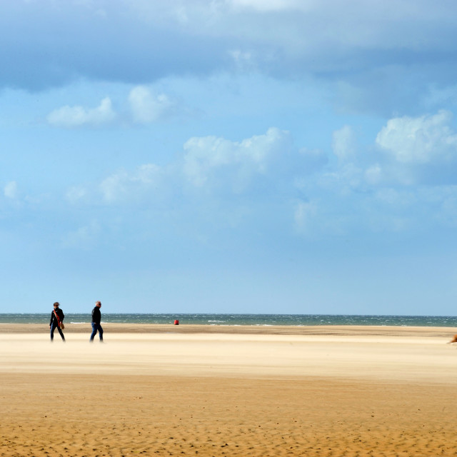 """Walking the Dog on the beach, Norfolk"" stock image"