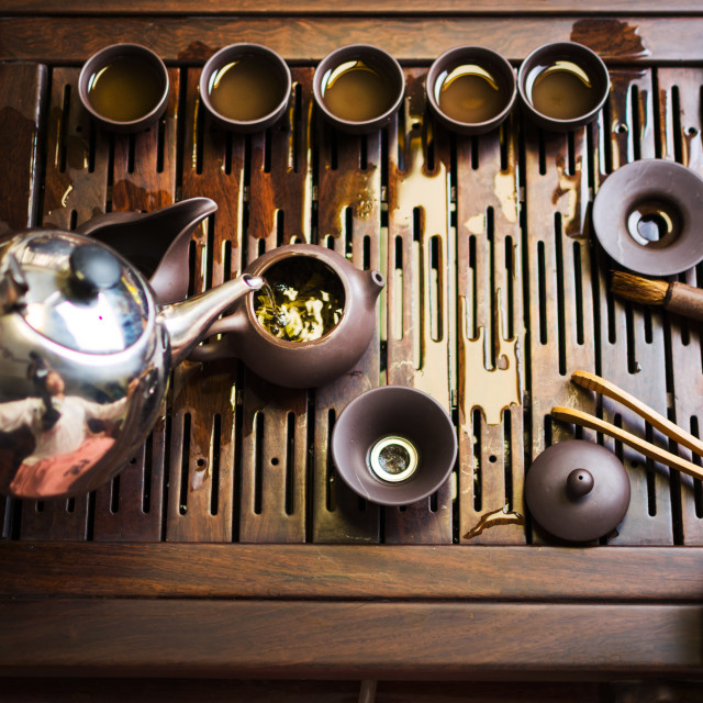 """Woman traditionally preparing Chinese tea in a Tea ceremony"" stock image"