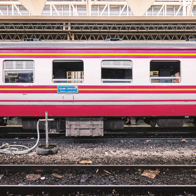 """""""BANGKOK, THAILAND - July 6, 2018: Side view of bogies of Thai train with passenger on the window waiting for departure at main central station"""" stock image"""
