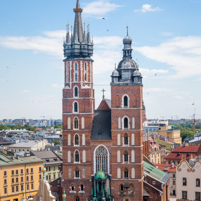 """St. Mary's Basilica (Bazylika Mariacka) on main square in Krakow, Poland. Tourist vacation holiday travel destination in Europe"" stock image"