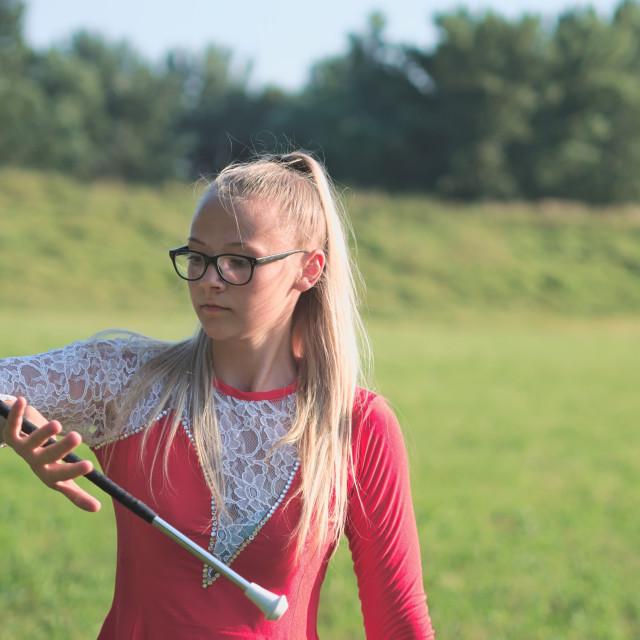 """""""Teen Majorette Girl Twirling Baton Outdoors"""" stock image"""