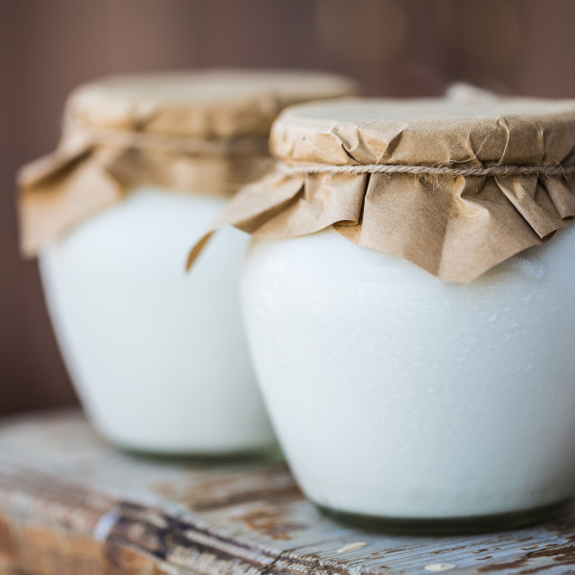 """Homemade milk yogurt in jars"" stock image"