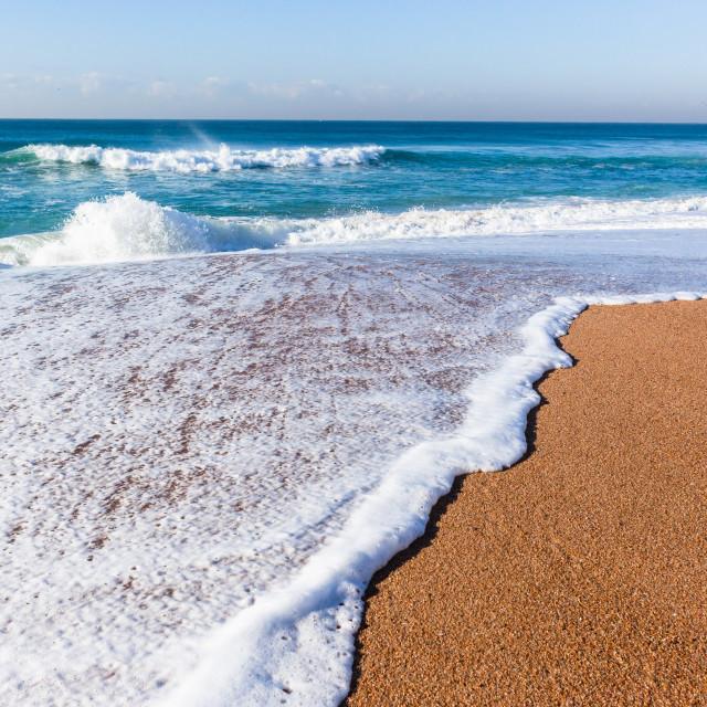 """Fishing Ocean Beach Shoreline Wash"" stock image"