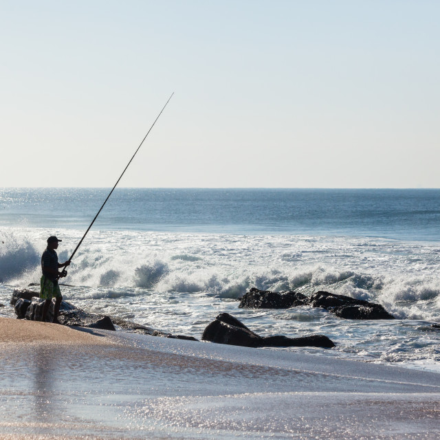 """""""Fishing Ocean Beach Silhouetted"""" stock image"""