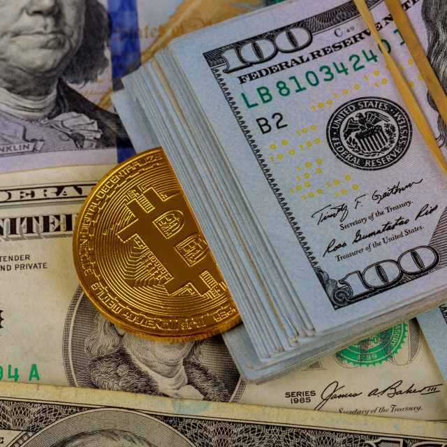 """Virtual cryptocurrency money Bitcoin golden coin on United States US dollar bill"" stock image"