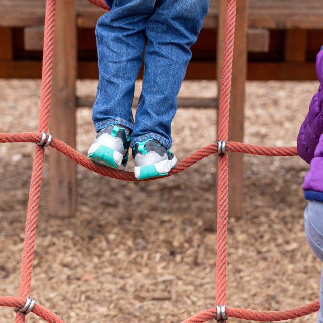 """""""Young children playing on a climbing frame"""" stock image"""