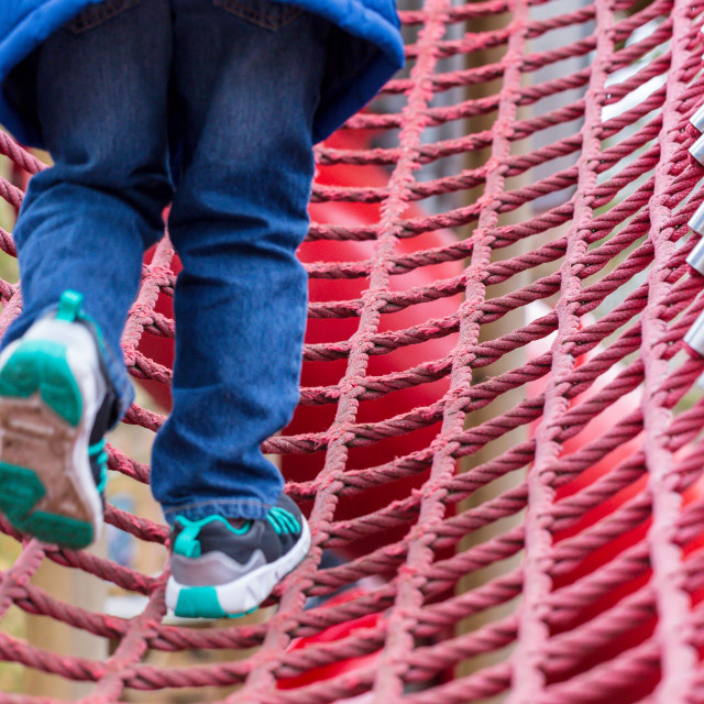 """""""Young boy on a rope climbing frame"""" stock image"""