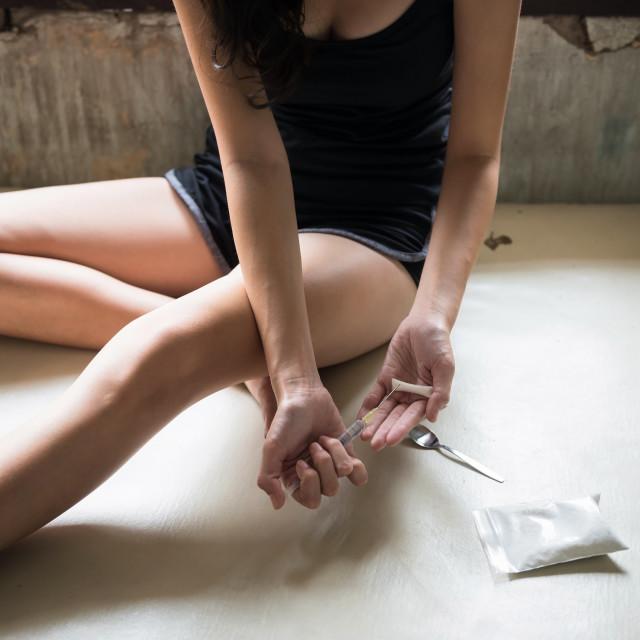 """Closeup female junkie hands holding drug"" stock image"
