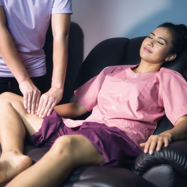 """calf and leg Thai massage in spa"" stock image"