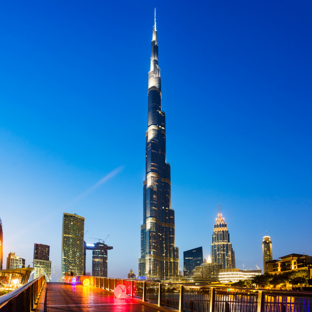 """Dubai, United Arab Emirates - May 18, 2018: Burj Khailfa, the tallest building in the world, rising high about the downtown Dubai"" stock image"