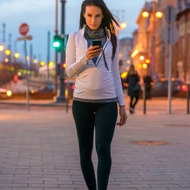 """""""Young woman on the street with a phone"""" stock image"""