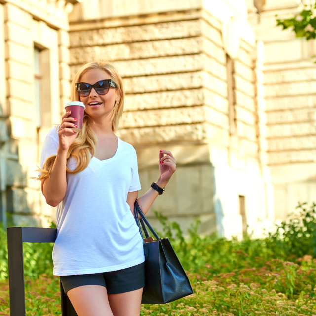 """""""Young woman having a coffee in front of an old building"""" stock image"""