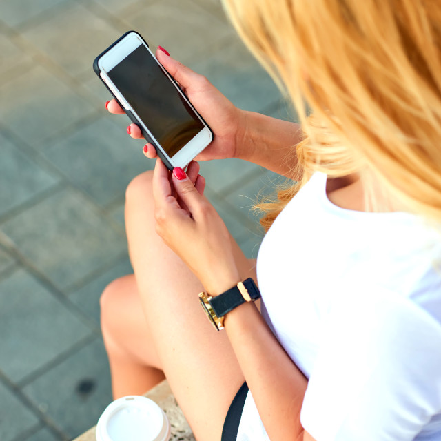 """""""Young woman with a mobile phone in her hands"""" stock image"""
