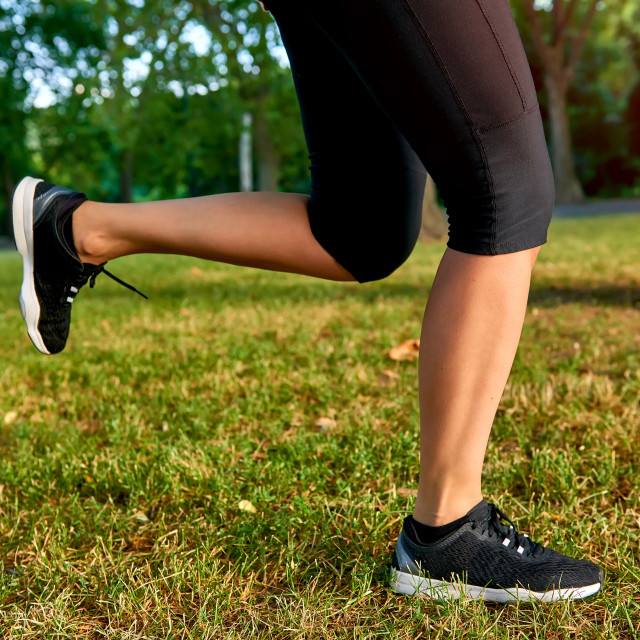 """""""The legs of a running woman"""" stock image"""