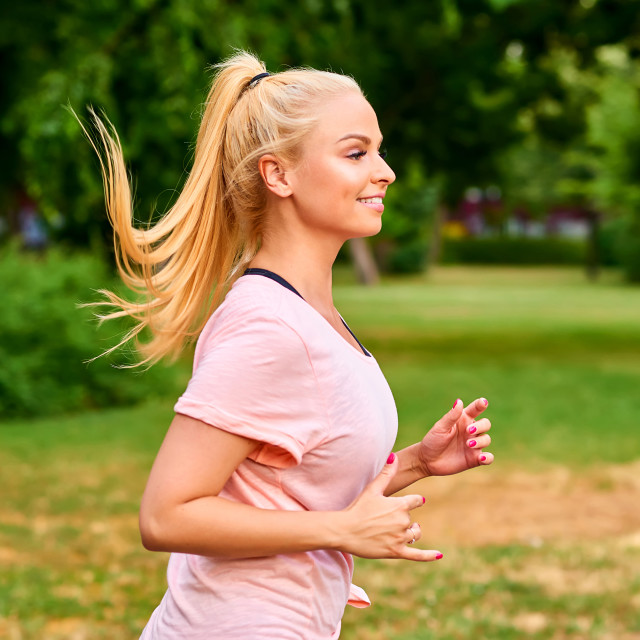 """""""Portrait of a young woman running"""" stock image"""