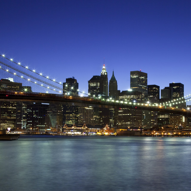 """Dusk at the Brooklyn Bridge - spanning the East River connecting Brooklyn and..."" stock image"