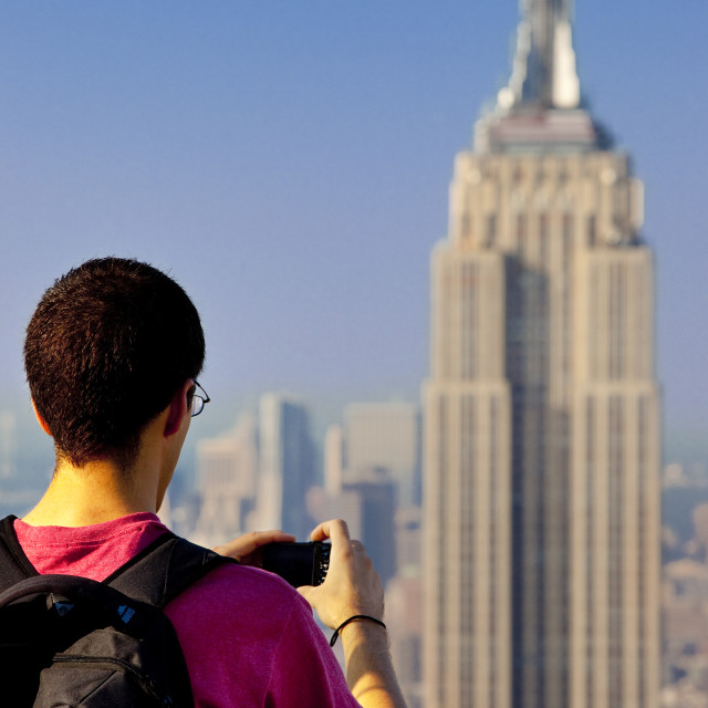 """Tourist capturing a photo of the Empire State Building from the top of the..."" stock image"