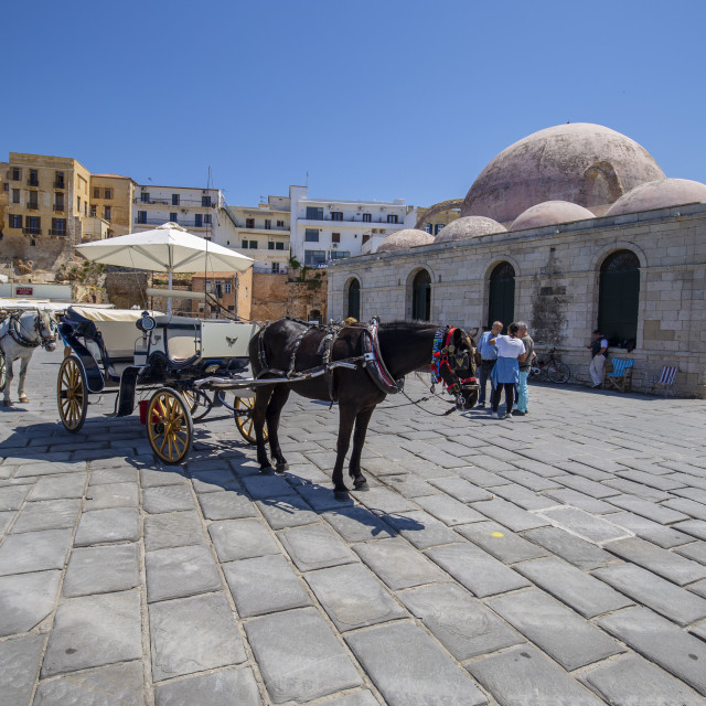 """""""Old Venetian Harbour at Chania city with the """"Gyali Tzami"""" and Horses"""" stock image"""