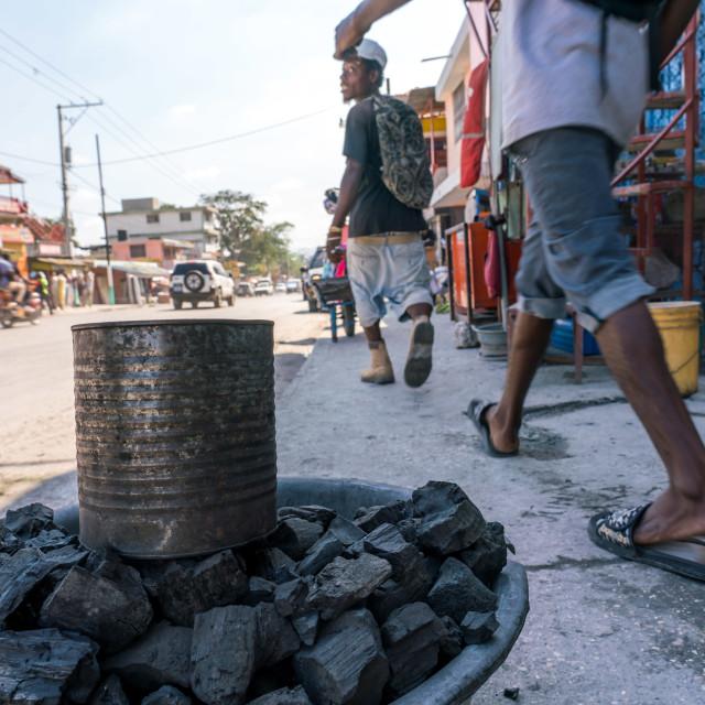 """Coal for sale on the streets of Port-au-Prince, Haiti"" stock image"