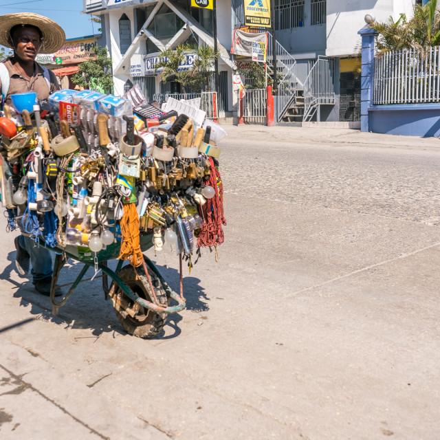 """Vendor on the streets of Port-au-Prince, Haiti"" stock image"