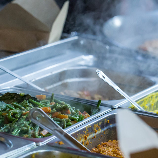 """""""Hot vegetarian food for sale on a market stall"""" stock image"""