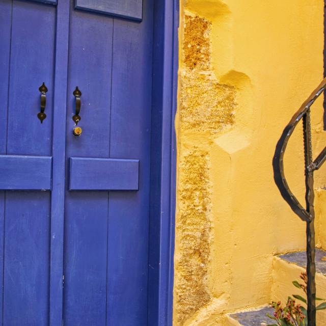 """Mediterranean blue door with yellow wall"" stock image"