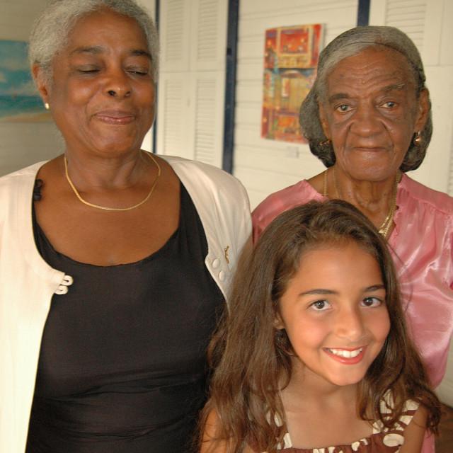 """Three generations of proud women"" stock image"