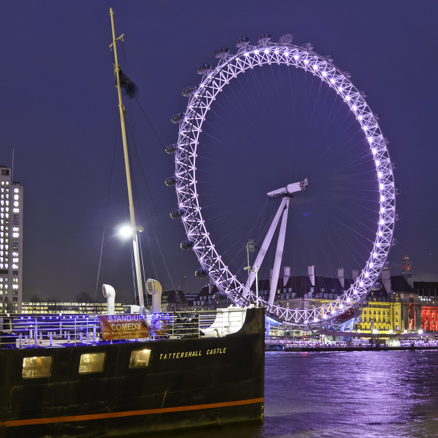 """The London Eye and Tattershall Castle at night"" stock image"