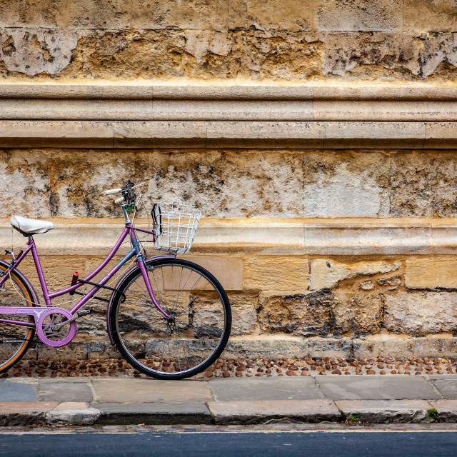 """""""Lady's Bike Parked Agains A Wall in Oxford"""" stock image"""