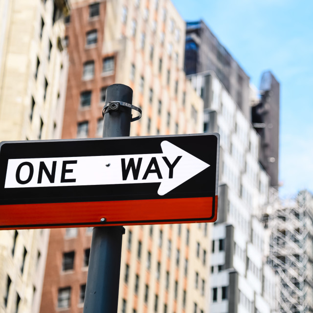 """""""Low angle view of directional sign against buildings in New York"""" stock image"""