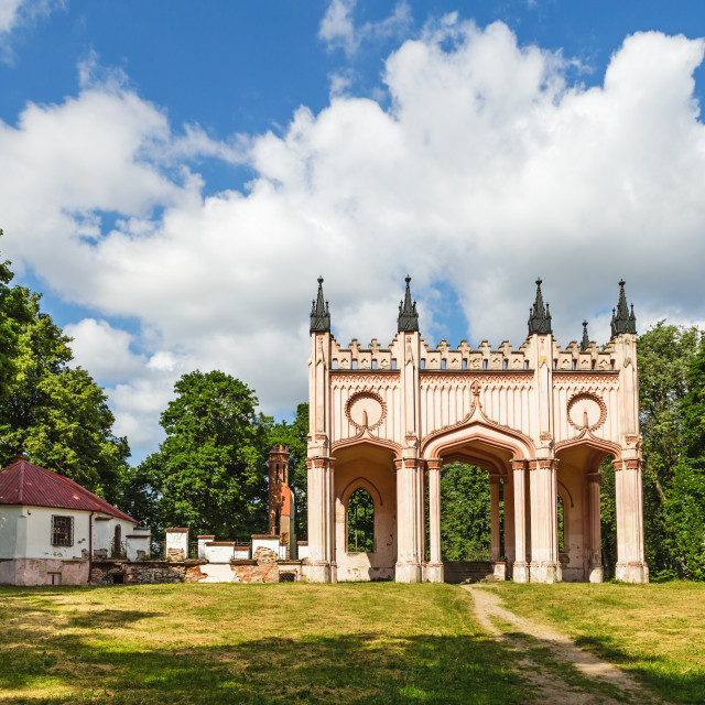 """Remains of Pac Castle under blue cloudy sky, Dowspuda, Poland"" stock image"